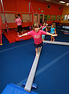 Students perfect their balance at The Little Gym in Brentwood on Saturday, May 19, 2012.  (Photo by Kevin Bartram)