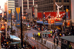 Metro light rail train running down Main Street in downtown Houston at Christmas