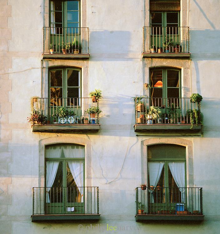 Architectural detail of small balconies near La Rambla in Barcelona, Spain