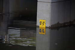 Stock photo of a flood marker reading in Houston Texas during Hurricane Ike