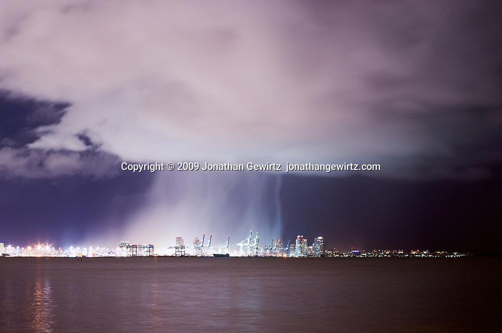 Nocturnal cloudburst over the Port of Miami, Florida. WATERMARKS WILL NOT APPEAR ON PRINTS OR LICENSED IMAGES.