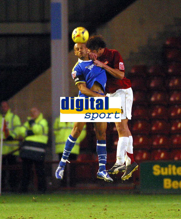 Photo: Dave Linney.<br />Walsall v Torquay United. Coca Cola League 2. 04/11/2006.Walsall's  Ian Roper(R) beats  Lee Thorpe<br />to the ball.