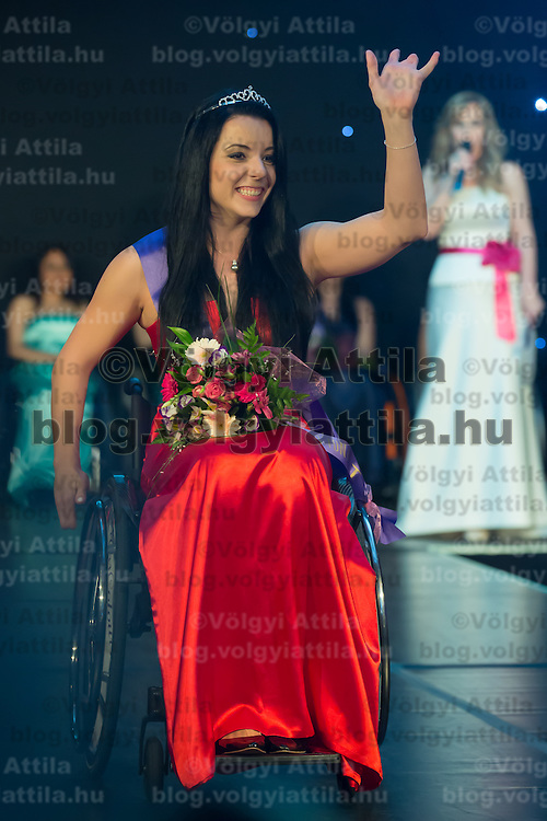 Fanni Illes of Hungary celebrates her victory during the Miss Colours International wheelchair beauty contest in Budapest, Hungary on March 22, 2014. ATTILA VOLGYI