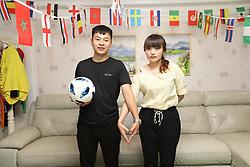 June 12, 2018 - Zhengzh, Zhengzh, China - Zhengzhou, CHINA-12th June 2018: Xiaorong, wife of a football fan, decorates their apartment with World Cup themed decorations in Zhengzhou, central China's Henan Province. (Credit Image: © SIPA Asia via ZUMA Wire)