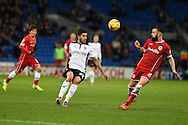 Emmanuel Ledesma of Rotherham Utd © looks to go past Cardiff's John Brayford. .Skybet football league championship match, Cardiff city v Rotherham Utd at the Cardiff city stadium in Cardiff, South Wales on Saturday 6th December 2014<br /> pic by Andrew Orchard, Andrew Orchard sports photography.