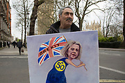 Political artist Kaya Mar with his Brexit painting on the day that Article 50 was invoked to start the process of Brexit from the European Union, protesters gather in Westminster to show their displeasure that Britain will be leaving the EU on March 29th 2017 in London, England, United Kingdom.