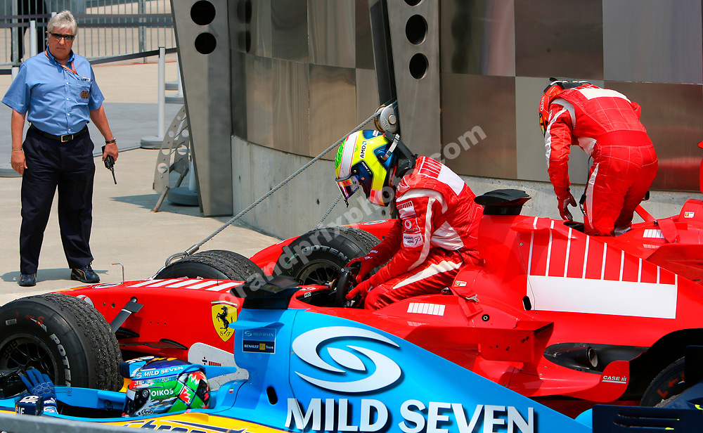 Ferrari drivers Michael Schumacher and Felipe Massa and Giancarlo Fisichella in parc ferme after the 2006 United States Grand Prix in Indianapolis. On the left is FIA official Herbie Blash. Photo: Grand Prix Photo