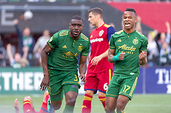 October 21, 2018 - Portland, OR, U.S. - PORTLAND, OR - OCTOBER 21, 2018: Portland Timbers players Larrys Mabiala and Jeremy Ebobisse celebrate Portland's first goal of the Portland Timbers 3-0 victory over Real Salt lake on October 21, 2018, at Providence Park in Portland, Oregon. (Photo by Diego Diaz/Icon Sportswire) (Credit Image: © Diego Diaz/Icon SMI via ZUMA Press)