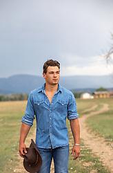 cowboy walking on a dirt road