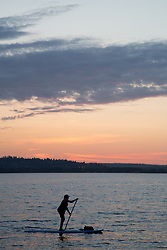United States, Washington, Kirkland (near Seattle), People on stand up paddleboards on Lake Washington