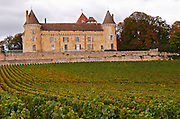 The medieval Chateau de Rully in Cote Chalonnaise, Bourgogne and it's vineyard planted with chardonnay