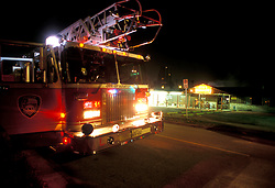 Stock photo of a Houston Fire Department fire truck parked street side at night
