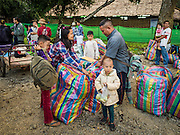 26 OCTOBER 2016 - NUPO TEMPORARY SHELTER, MAE CHAN, TAK, THAILAND:  A family of Burmese refugees in the Nupo Temporary Shelter refugee camp waits to be repatriated back to Myanmar. Sixtyfive Burmese refugees living in the Nupo Temporary Shelter refugee camp in Tak Province of Thailand were voluntarily repatriated to Myanmar. About 11,000 people live in the camp. The repatriation was the first large scale repatriation of Myanmar refugees living in Thailand. Government officials on both sides of the Thai / Myanmar border said the repatriation was made possible by recent democratic reforms in Myanmar. There are approximately 150,000 Burmese refugees living in camps along the Thai / Myanmar border. The Thai government has expressed interest several times in the last two years in starting the process of repatriating the refugees.    PHOTO BY JACK KURTZ