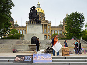 """18 MAY 2020 - DES MOINES, IOWA: People opposed to mandatory vaccines break down their anti-vaccination signs after a prayer vigil. About eight adults, and their children, gathered in the front of the Iowa State Capitol in Des Moines Monday for a prayer vigil against mandatory vaccines. Iowa state law allows the governor to mandate vaccines for communicable diseases during a public health emergency and the """"anti-vaxxers"""" are afraid the government will mandate a vaccine for Coronavirus (SAR-CoV-2) if one is developed. As of May 18, 355 people in Iowa have died from COVID-19, the disease caused by the Coronavirus (SARS-CoV-2), and 14,955 have tested positive for the Coronavirus.              PHOTO BY JACK KURTZ"""