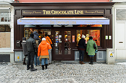Chocolate lovers wait outside in the cold for other customers to leave the shop as the Chocolate Line in Bruges, Belgium is often filled to capacity with customers. (Simon Stevinplein 19 ; 32-50-34-10-90 ; thechocolateline.be ). (Photo © Jock Fistick)