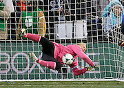 Sporting Kansas City goalkeeper Jimmy Nielsen blocks a shot during a shoot out in overtime against Real Salt Lake during the MLS Cup final soccer match in Kansas City, Kan., Saturday, Dec. 7, 2013. (AP Photo/Colin E. Braley)