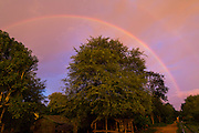 29 JUNE 2013 - BATTAMBANG, CAMBODIA: A rainbow over a village at sunset in rural Cambodia near Battambang.     PHOTO BY JACK KURTZ