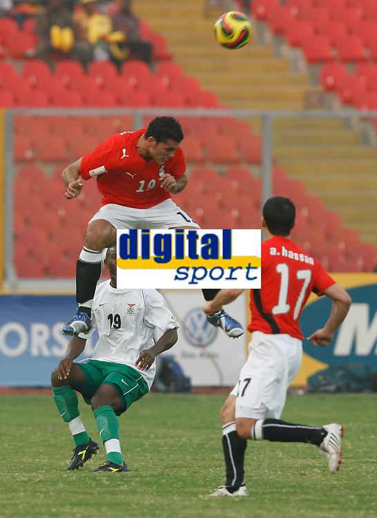 Photo: Steve Bond/Richard Lane Photography.<br /> Egypt v Zambia. Africa Cup of Nations. 30/01/2008. Amr Zaki (upper) gets his head to the ball