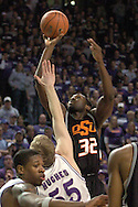 Oklahoma State's David Monds (32) puts up a shot over Kansas State's Tyler Hughes (55) at Bramlage Coliseum in Manhattan, Kansas, February 4, 2006.  The Cowboys  defeated K-State 63-61.