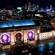 Elevated view of Kansas City's Union Station in the evening and downtown skyline in background.