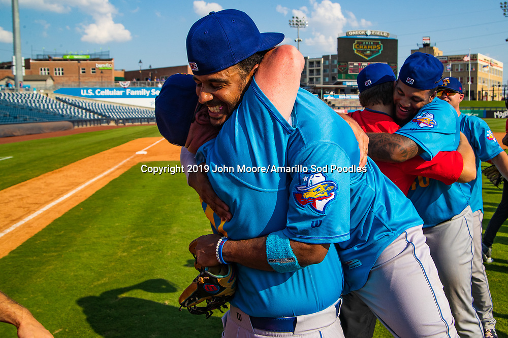 Amarillo Sod Poodles Manager Phillip Wellman and Amarillo Sod Poodles pitcher Luis Patino (35) celebrates after the Sod Poodles won against the Tulsa Drillers during the Texas League Championship on Sunday, Sept. 15, 2019, at OneOK Field in Tulsa, Oklahoma. [Photo by John Moore/Amarillo Sod Poodles]