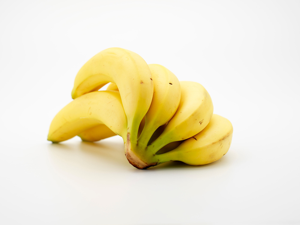 Bunch of fresh yellow bananas on a white background