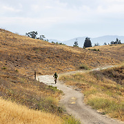 Mountain bikers take advantage of the fireroads as they traverse the expansive hills of the Santa Monica Mountains near Victory Trailhead.