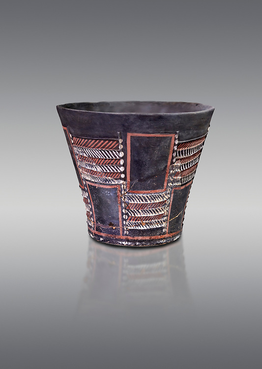 Minoan Kamares Ware sup with bold geometric polychrome decorations , Phaistos 1900-1700 BC; Heraklion Archaeological  Museum, grey background.<br /> <br /> This style of pottery is named afetr Kamares cave where this style of pottery was first found .<br /> <br /> If you prefer to buy from our ALAMY PHOTO LIBRARY  Collection visit : https://www.alamy.com/portfolio/paul-williams-funkystock/minoan-art-artefacts.html . Type -   Heraklion   - into the LOWER SEARCH WITHIN GALLERY box. Refine search by adding background colour, place, museum etc<br /> <br /> Visit our MINOAN ART PHOTO COLLECTIONS for more photos to download  as wall art prints https://funkystock.photoshelter.com/gallery-collection/Ancient-Minoans-Art-Artefacts-Antiquities-Historic-Places-Pictures-Images-of/C0000ricT2SU_M9w