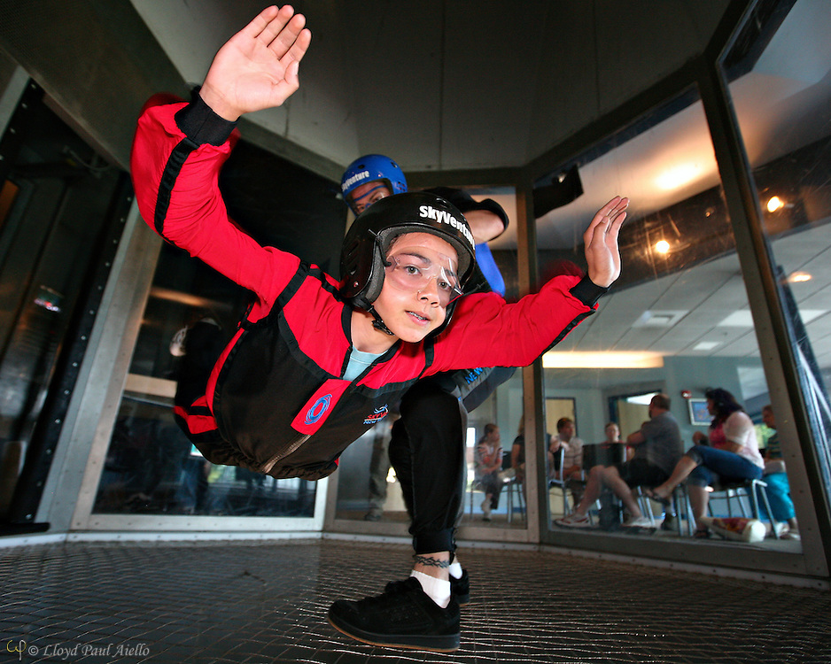 """AJ (age 12) """"Skydiving"""" with the instructor in the wind tunnel, Sky Ventures, Nashua, New Hampshire."""