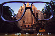 Aukana, Sri Lanka. 5th century Buddha thru glasses of Sir Arthur C. Clarke. Sir Arthur is best known for the book 2001: A Space Odyssey.