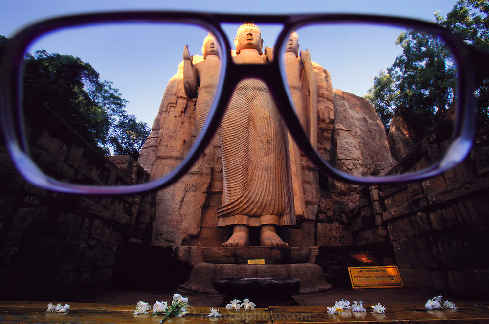 Aukana, Sri Lanka. 5th century Buddha thru glasses of Sir Arthur C. Clarke. Sir Arthur is best known for the book 2001: A Space Odyssey.