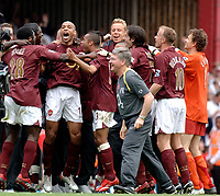 Photo: Daniel Hambury.<br />Arsenal v Wigan Athletic. The Barclays Premiership. 07/05/2006.<br />Arsenal's skipper Thierry Henry leads the celebrations as the team realise they have made it into the Champions League.
