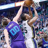 27 January 2016: Utah Jazz guard Rodney Hood (5) is fouled by Charlotte Hornets forward Spencer Hawes (00) during the Utah Jazz 102-73 victory over the Charlotte Hornets, at the Vivint Smart Home Arena, Salt Lake City, Utah, USA.