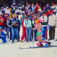 Half-naked skiers ski the Bikini Race at Copper Mountain Ski Area, Colorado.
