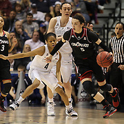 Makenzie Cann, Cincinnati, defended by Moriah Jefferson, UConn, in action during the UConn Vs Cincinnati Quarterfinal Basketball game at the American Women's College Basketball Championships 2015 at Mohegan Sun Arena, Uncasville, Connecticut, USA. 7th March 2015. Photo Tim Clayton
