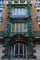 Ornate Paris Window- Thousands of doors, windows and gates adorn buildings in Paris.  Some of the best are on government offices, cathedrals and churches, as well as a few chateau.  However, any self-respecting contractor with a decent budget probably spent a lot of consideration in installing suitable doors, windows, grill work and even doorknobs. Some of these gates, doors and windows are very simple, while others are extravagant works of art. The styles of these doors tell about the history of France. As you walk across the 20 arrondissements of Paris, you will discover Gothic, Renaissance, Haussmann and Art Nouveau door styles. It is up to you to take the time to look for little details of these Paris' most beautiful doors with statues, bas-reliefs, mascarons, gold-leaf, grills, handles and door knobs.