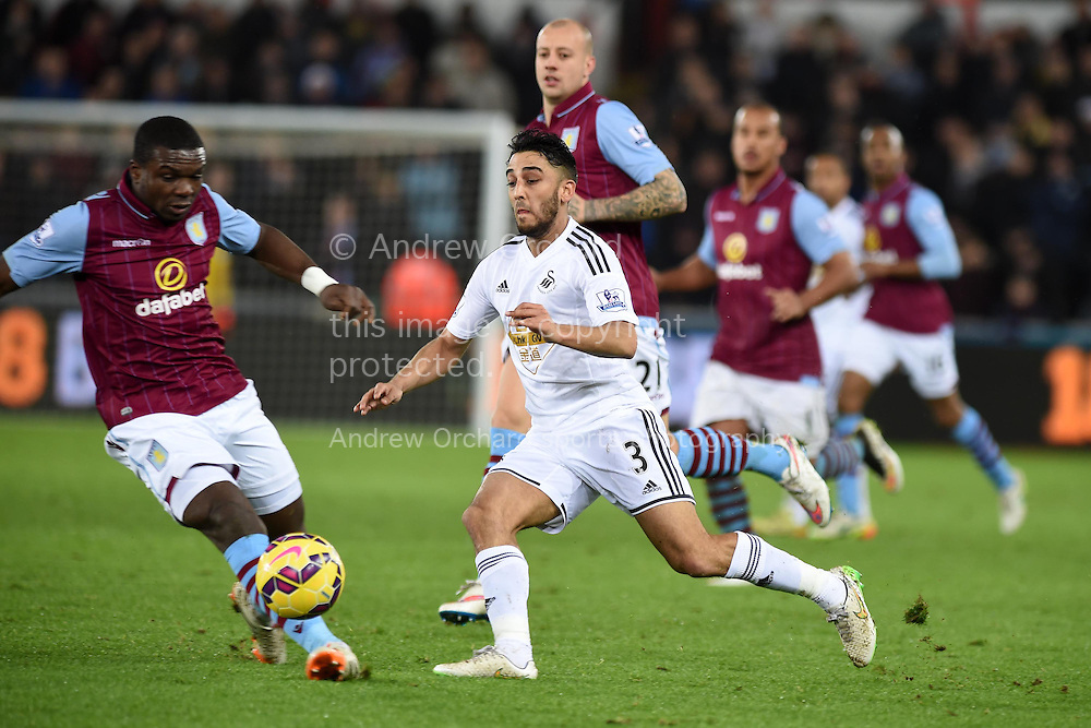 Neil Taylor of Swansea city © looks to go past Jores Okore of Aston Villa. Barclays Premier league match, Swansea city v Aston Villa at the Liberty stadium in Swansea, South Wales on Boxing Day, Friday 26th December 2014<br /> pic by Andrew Orchard, Andrew Orchard sports photography.