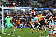 Joey Barton of Burnley (13) heads toward goal but sees his effort saved. Skybet football league Championship match, Burnley v Hull city at Turf Moor in Burnley ,Lancs on Saturday 6th February 2016.<br /> pic by Chris Stading, Andrew Orchard sports photography.