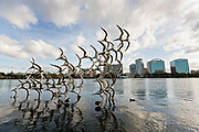 Sculpture Take Flight by artist Douwe Blumberg on Lake Eola in Orlando, Florida. Lake Eola Park is located in the heart of Downtown Orlando and home to the Walt Disney Amphitheater.