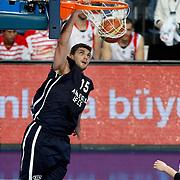Anadolu Efes's Estaban Batista (L) during their Turkish Basketball League match Anadolu Efes between Bandirma Kirmizi at Sinan Erdem Arena in Istanbul, Turkey, Saturday, December 24, 2011. Photo by TURKPIX