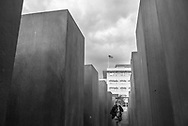 Berlin, Germany - September 6, 2015: View toward the United States embassy in Berlin, Germany, seen from within the Berlin Holocaust Memorial. More formally called The Memorial to the Murdered Jews of Europe, the memorial was inaugurated in 2005. The U.S. Embassy building was inaugurated in 2008.