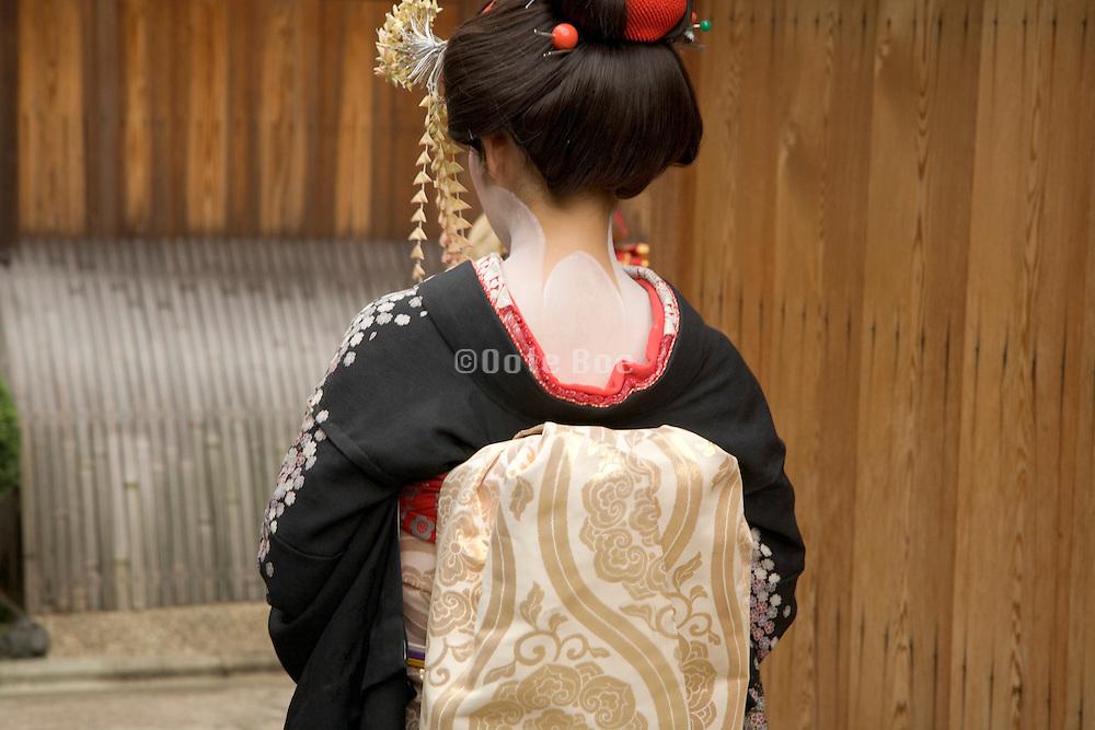 back view of a maiko in traditional kimono dress Kiyomizu district in Kyoto Japan