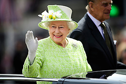 ©  London News Pictures. 21/04/2016. Windsor, UK. HRH QUEEN ELIZABETH II in an open top Land Rover during a drive through the town of Windsor, Berkshire on the day of her 90th birthday.  Photo credit: Ben Cawthra/LNP