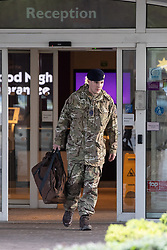 © Licensed to London News Pictures. 22/04/2018. Manchester, UK. A member of the Royal Logistics Corps Bomb Disposal team at the hotel . Police are responding to a suspect package at a premier Inn Hotel near to Victoria Station in Manchester City Centre . The bomb squad are in attendance and the hotel has been evacuated . Photo credit: Joel Goodman/LNP