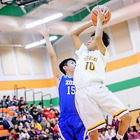 Tohatchi Cougar Justin Leonard (10) floats above Zuni Thunderbird Marlon Lowsayatee (15) to score  during the Wingate Holiday Classic basket ball tournament at Wingate High School Thursday.
