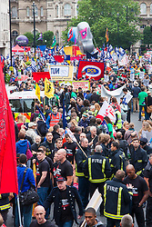 London, July 10th 2014. Part of the large crowd waiting to set off as thousands of striking teachers, government workers and firefighters march through London in protest against cuts and working conditions.
