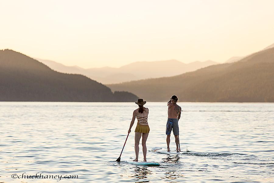 Paddleboarding on Whitefish Lake at sunset in Whitefish, Montana, USA model released