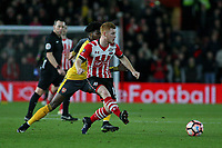 Football - 2016 / 2017 FA Cup - Fourth Round: Southampton vs. Arsenal<br /> <br /> Southampton's Harrison Reed under pressure from Ainsley Maitland-Niles of Arsenal at St Mary's Stadium Southampton England<br /> <br /> COLORSPORTt/SHAUN BOGGUST