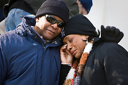 Lady in tears comforted while watching inauguration of Barack Obama from front steps of Lincoln Memorial, Washington D.C., USA.
