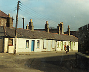 Old amateur photos of Dublin streets churches, cars, lanes, roads, shops schools, hospitals, Streetscape views are hard to come by while the quality is not always the best in this collection they do capture Dublin streets not often available and have seen a lot of change since photos were taken St Patricks Home Navan Rd, pim st, Kilmainham lane, Thatched Cottage Skerries, Phibsboro, Hole in the Wall, Blackhorse avenue, James cottage martins shop, players please, May 1983